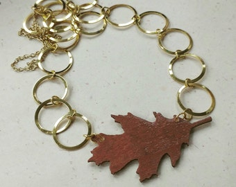 Brown leaf ling necklace with gold toned chain
