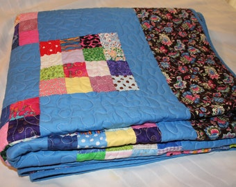 Patchwork multi color quilt with country blue blocks. Bed Size