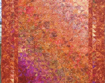 Lap Quilt With the Pinwheeel Block and Gradation in Warm Colored Batiks
