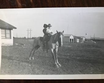 Vintage Horse photo riding double on a lanky horse