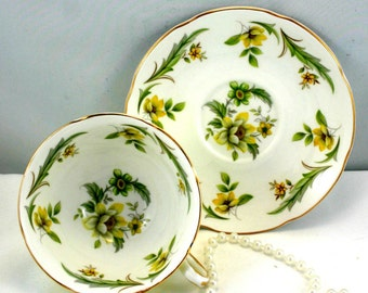 Royal Grafton Teacup & Saucer, Lovely Floral Pattern on White Background,Pale Green Borders, Gold Rims, Bone English China made in 1960s.