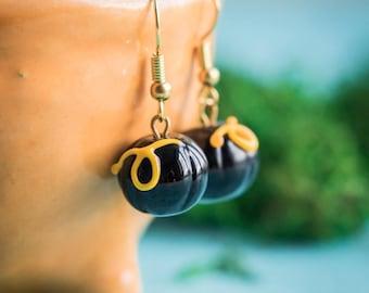 Halloween earrings_puffy black pumpkins_handmade lampwork_black yellow pumpkins_plant botanical jewelry_spooky earrings_glass Jack-o-Lantern