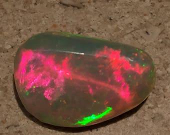 AAA 6.95Ct. Ethiopian broad flash Opal