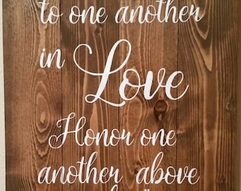 Be Devoted To One Another sign