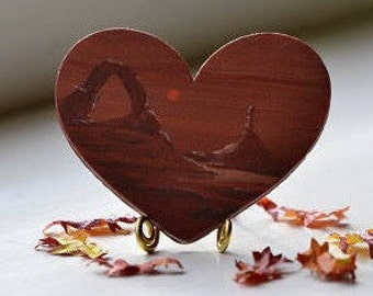 Moon rising over Red Rock Desert painting on a mini wooden heart