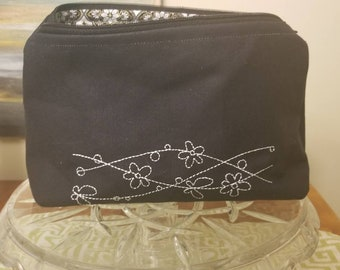 Black embroidered and lined makeup bag