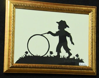 Boy With Wheel - Scherenschnitte - Hand Paper Cutting Art signed and dated By Janet Lynch -5x7 Framed