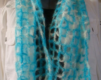 Lacy hand crocheted scarf is a beautiful accessory in varigated blue and white.