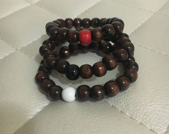Dark wood bracelets with a pop of color!