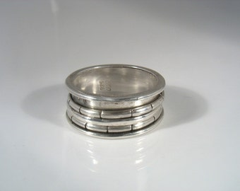 Eternity - three sterling silver spinners rotating on silver band unisex ring