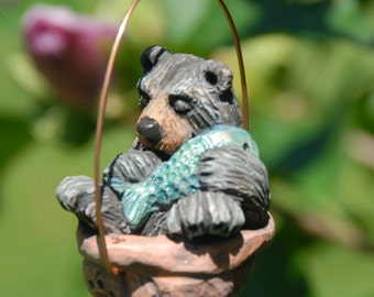 Sleeping black bear walnut ornament