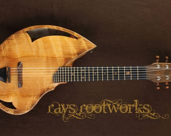 Guitalele. Nylon string acoustic travel guitar./ukulele. Handmade musical instrument. By Rays Rootworks. Fibonacci shape.