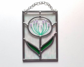 Handmade Agapanthus flower panel in stained glass incorporating a fused glass flower head.
