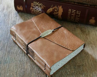 """Leather Journal - """"It's never too late to be what you might have been"""" - George Eliot . handmade handbound . tan / honey brown (320pgs)"""