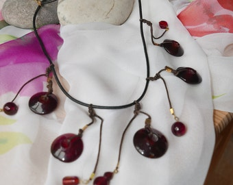 Beaded leather cord red glass discs necklace