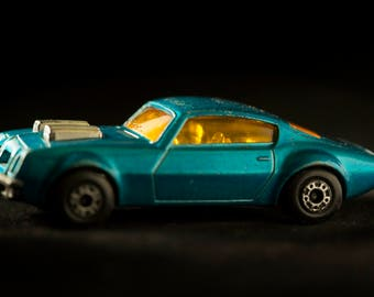 Photograph of a Vintage Toy Racecar.