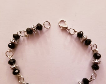 Black and flat silver beaded bracelet