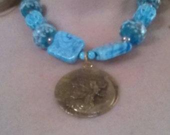 Blue Fairy on a crescent moon.