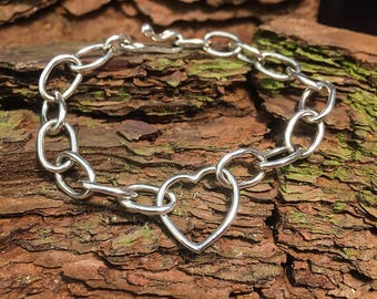 Silver chain link bracelet with heart link
