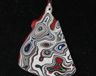 Fordite cabochon, red white green black gray,  15ct (2)
