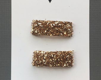 TWO bronze glitter snap clips