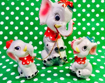 Artmark Anthropomorphic Elephant Family of 3 Chained Figurines in Bows and Ruffles made in Japan circa 1950s
