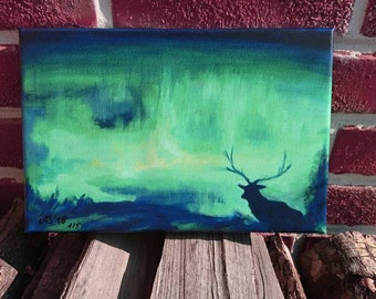 Northern Lights with reindeer-mystical light