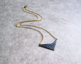 Oxidised silver geometric hole-patterned pendant on fine gold-filled chain