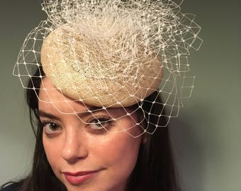 Handmade pillbox hat with net detail. on elastic fitting attachment