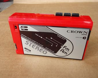 vintage red walkman cassette player recorder deck portable am fm radio,crown japan,retro 80s prop,does not work needs fix.incomplete