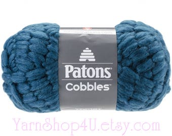 TETRA TEAL. Patons Cobbles Super Bulky Wool Blend Yarn. Content % is 49 Wool/ 49 Acrylic/ 2 Nylon. Acrylic Blend. Dark Blue Teal Super Bulky