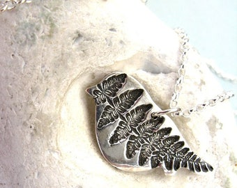 Fine silver bird necklace with fern pattern