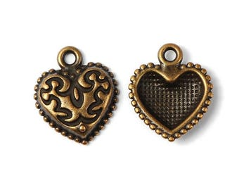 Antique bronze metal worked heart charm