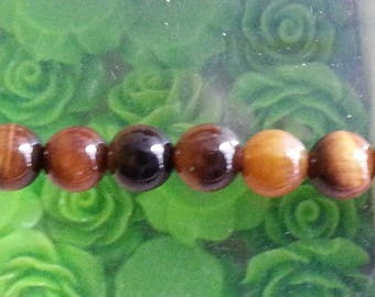 5 of 6 mm Tiger's eye bead, hole 1 mm