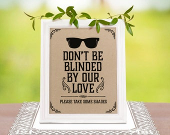 Rustic wedding decor: dont be blinded by our love printable sign on a kraft paper. Wedding favors rustic decorations. Sunglasses favors sign
