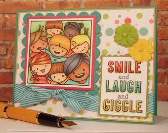 Handmade Greeting Card with hand stamped and colored image of happy, little, kids taking a selfie, bright colors, cheeerful, happy, fun
