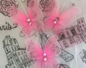 Bulk butterfly paperclips