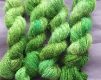 A skein of hand dyed yarn, baby suri alpaca x  merino x bamboo, Shades of Green and some Pastel Turquoise