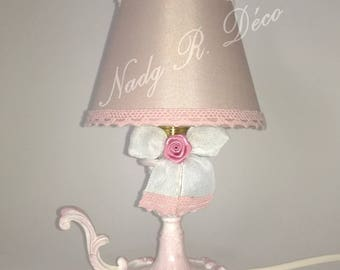 Small light pink and white romantic. Old revamped brass candle holder.