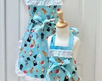 Puppy Dogs on Turquoise with Tiny White Polka Dots and Snow White Eyelet Mommy and Me Apron Set  - reversible