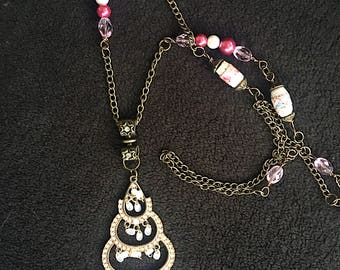 Vintage pinks and shimmering brass long pendant necklace with repurposed earring and glass beads