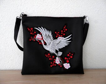 Faux black leather and heron embroidery handbag