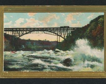Vintage Color Postcard of a Train on a Bridge Crossing a Raging River
