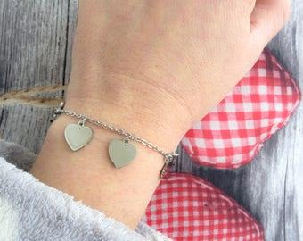 Silver bracelet with heart pendants