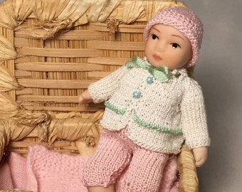 Bella, baby for dollhouse, porcelain, knitted clothing set