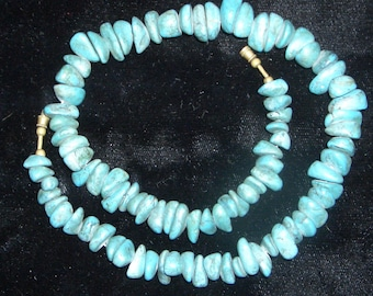 necklace of turquoise beads