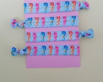 Set of 4 seahorse elastic hair ties
