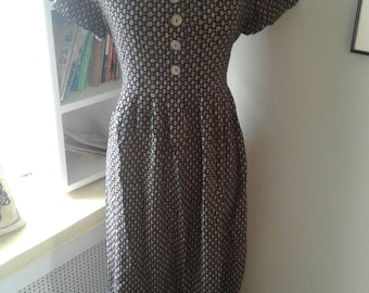 Vintage long dress....black with beige mini print......ties in the back....80s....large wooden  buttons