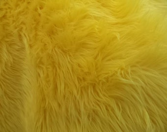 "Yellow shaggy faux fur upholstery fabric per yard 60"" Wide"