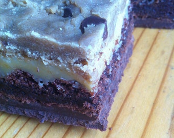 The Ultimate Traybake - Chocolate fudge, brownie, caramel and cookie dough layers! (9 squares)